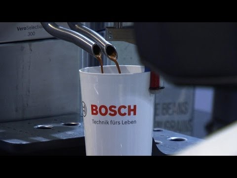 Robot barista makes custom coffee
