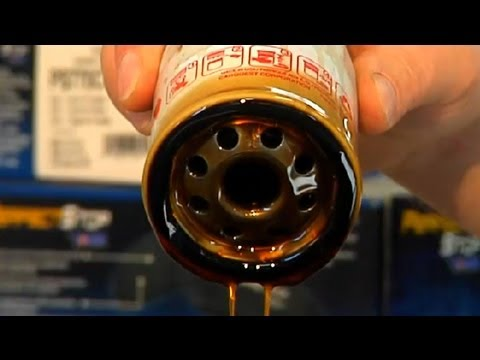 Advantages & Disadvantages of Changing the Oil in a Car by Yourself : Under the Car Repairs