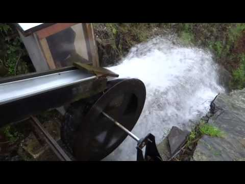 Off-grid energy: small water wheel supplying winter power in Portugal
