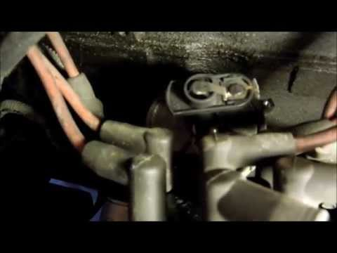 How to change distributor cap and rotor on a jeep wrangler  tune up part 2 of 3