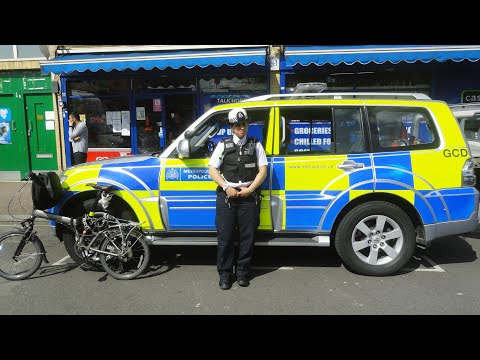 A brief encounter with a London Police Officer & a peek inside her car, Queens Crescent, Camden