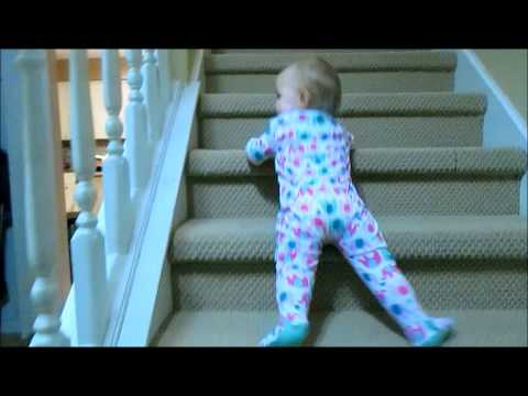 Little Girl Has Unique Way of Getting Herself Down the Stairs