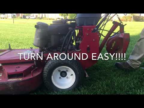 When can I mow my grass after seeding?