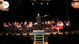 """Nieuwjaarsconcert 2015 - Koninklijke Harmonie Unie Sevenum 2015 Second Waltz (Waltz no. 2) - Dmitri Sjostakovitsj arr. Johan de Meij  Suite voor Variété Orkest is een verzameling van korte composities van de Russische componist Dmitri Sjostakovitsj. Hoewel vele mensen de naam Sjostakovitsj niks zal zeggen, kennen ze wél de wals nr. 2 uit deze compositie voor orkest. De wals is bekend geworden bij het """"grote publiek"""" door de uitvoering van André Rieu. Voor Rieu kwam de grote doorbraak in 1994 met de Tweede Wals die een onverwacht (hit)succes werd. Sindsdien reist hij over de hele wereld met spektakels waar hij klassieke muziek, salonmuziek, operette, soundtracks en popmuziek speelt voor niet alleen doorgewinterde concertbezoekers, maar ook voor een publiek dat voorheen niet of nauwelijks naar orkestuitvoeringen ging.  Het is dan ook aan Rieu te danken dat de second wals als compositie binnen klassieke muziek voorkomt in de Top 2000 (Nederland) van Radio 2, normaliter een zender voor popmuziek."""