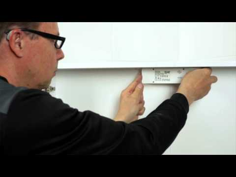 Installing A High Cabinet And A Mirror Cabinet With Built in Lighting
