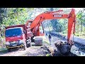 Digger Loading Dump Truck Doosan DX225LCA Excavator