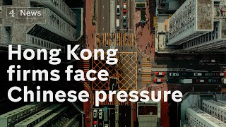 Hong Kong: Firms under pressure from China to toe government line