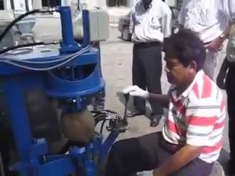 Coconut shell cover removing machine