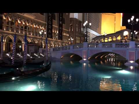 A Gondola Sailing in front of the Venetian Hotel in the Evening