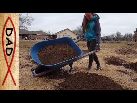 Best fix for a sandy garden - truckload of dirt and hard work.