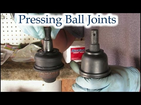 Learn how to replace a lower ball joint on an SUV - Banging required
