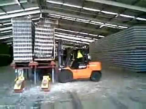Forklift Driver Breaks Tons of Glass Bottles.flv