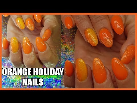 ORANGE ACRYLIC NAILS WITH FAIRY DUST GLITTER