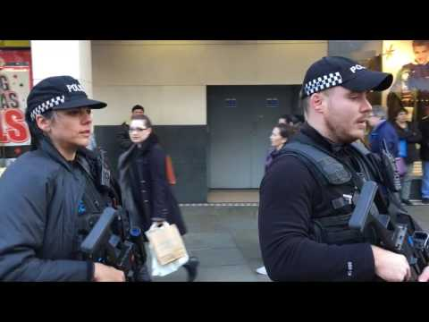 Armed police officers patrol Nottingham city centre