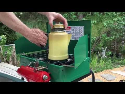 Coleman Camp Stove brewing coffee with a percolator.