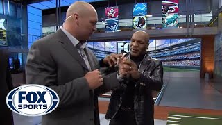 Mike Tyson gives Brian Urlacher boxing lessons