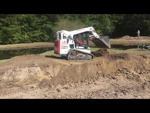 Bobcat T590 building jumps at the motocross track