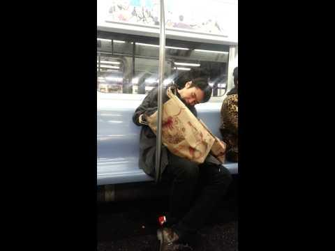 Man eating while sleeping on NYC subway!!!