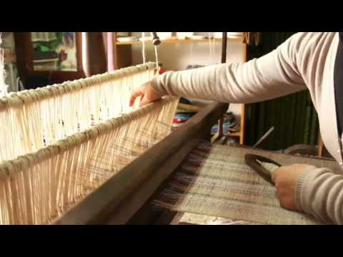 Working with an ancient handloom dated back to 1600