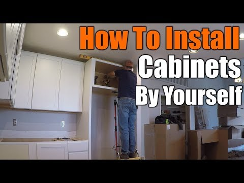 How To Install Upper Kitchen Cabinets By Yourself | THE HANDYMAN  |