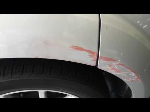 Removing auto  paint scuffs with Goof -Off