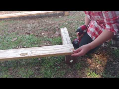 Daughter using a brushless Milwaukee M18 Impact Drill to put together box garden