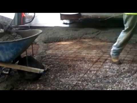 Armstrong masonry pouring a concrete patio