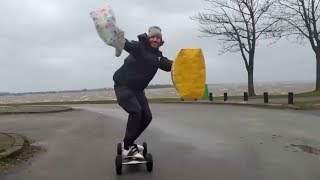 Guy kiteboards with grocery bags during storm