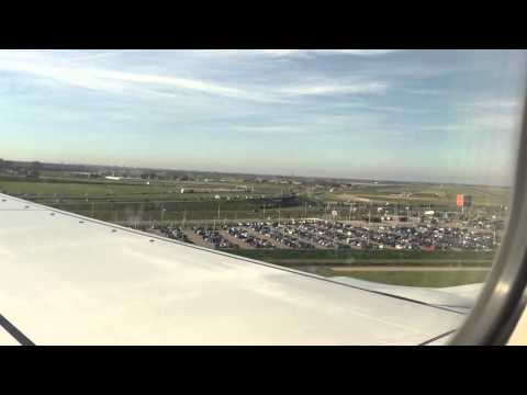 The approach into Amsterdam Schiphol Airport on a KLM flight from Manchester (Boeing 737-800).