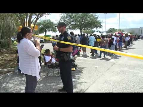 Thousands line up for disaster food assistance