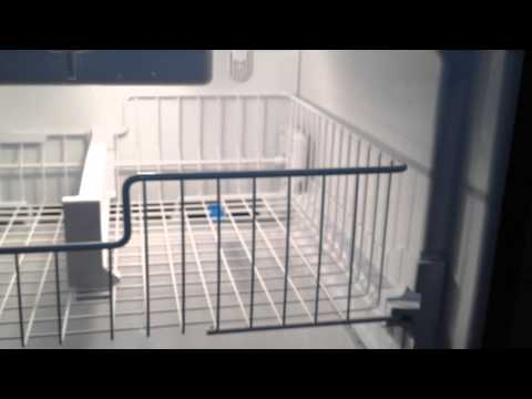 How to Remove the Top Rack Inside the Freezer Compartment of a Whirlpool Bottom-Mount Refrigerator