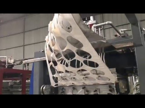 Thermoforming Machine with Robotic Stacker