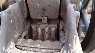 antique rock crusher powered by tractor