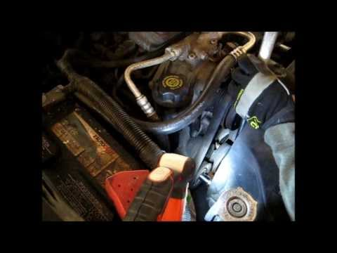 How to remove a serpentine belt and loosen belt tensioner. Jeep Grand Cherokee WJ.