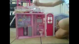 playing with barbie doll house