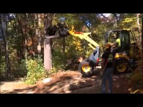 Using my new Gehl Al540 to push over a pine tree in Windham, NH.