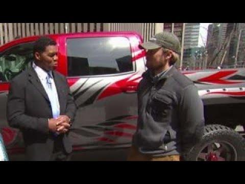 Herschel Walker presents veteran with custom truck