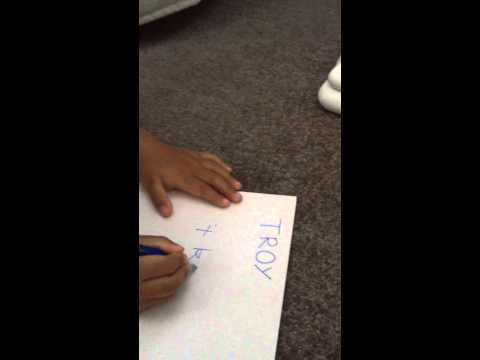 Troy writing his name for the first time