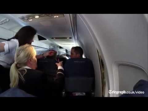 Watch: plane's cabin panels split open mid-flight
