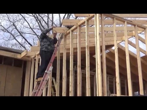 Cutting the rafter tails for the fascia on the Homestead cabin