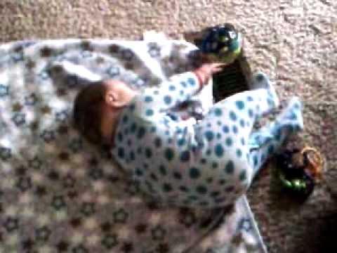 Baby Bradyn learning to roll over