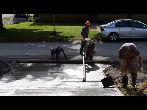 Pouring a sloped concrete driveway