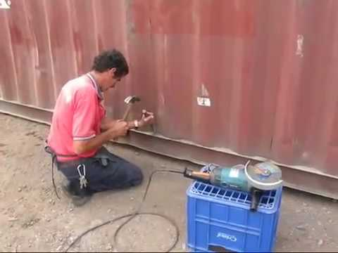 Cutting The Steel Door of a shipping container