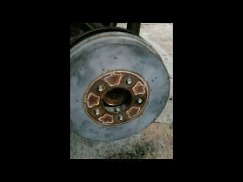 Ford Escape 2010 drum brake shoes adjusted