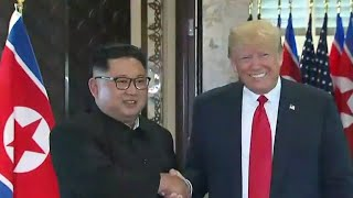 "Trump and Kim Jong Un sign ""comprehensive"" document, concluding summit"