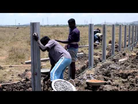 Erecting a concrete fencing posts