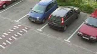 Woman trying to reverse out of parking space.