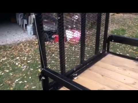 Trailer tail gate spring assist lift gate