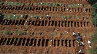 Bolsonaro under fire as mass graves dug in coronavirus hit Brazil