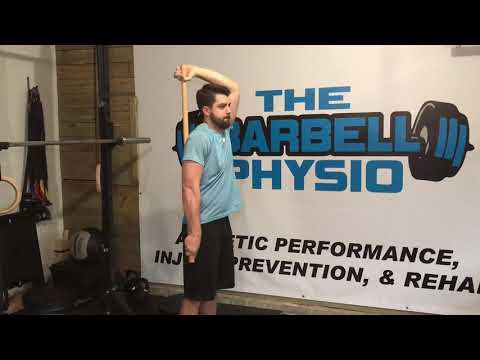 Shoulder extension stretch with dowel